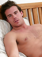 Jakob is a competitive swimmer and when he lifts up his shirt you can see he let his hair grow back a little! He has a fine body with good muscle definition and stopped shaving two weeks before the shoots so is partly hairy! When he turns round you can en