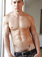 After interviewing one another, Adam Killian and Mike Colucci strip one another out of their button-down shirts and Adam drops to his knees to feast on Mike through his underwear. He plays with Mike's bubble butt and strips him clean. He then dives into M