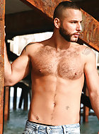 Hot on the case to find the missing Diego Cruz, Jonathan Agassi cruises local Spaniard Ivan Rueda, hoping to mine him for information and his ass! The two scruffy, tattooed studs get it on gratuitously. Ivan swallows Jonathan's thick hard-on to the base,
