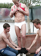 Hayden is back for a new shoot and as he lies back in the sun 4 pairs of hands start roving his body! As Kev and Jason play pull of Haden's vest they explore into his shorts which are soon round his ankles as Kev and Jason lick every inch of Haydon's